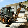 5-25-12<br /> Operator Troy Coons and Bill Brewer, with Keith Sullivan Excavating, spread top soil behind the new Kokomo Howard County Library building that will house the Bookmobiles. <br /> KT photo | Tim Bath