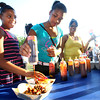 6-9-12<br /> Ribfest at Foster Park<br /> Jaya Ferguson, 11, Rickyua Listenbee, 12, and Tiffany Listenbee(Rickyua's mom and Jaya's aunt) putting bbq suace on the pulled pork sandwich.<br /> KT photo | Tim Bath