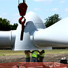 6-7-12<br /> Northwestern School Corporation's wind turbine being erected. Bolts are screwed in to the base of the turbine before it is lifted into place.<br /> KT photo | Tim Bath