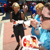 6-7-12<br /> Strawberry Festival downtown<br /> Joy Schafer, Chris Trine and Allison Thomas eating strawberry shortcakes on Main Street.<br /> KT photo | Tim Bath