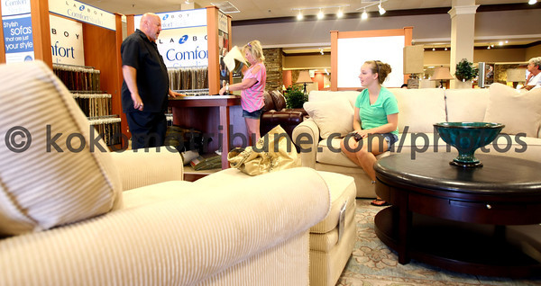 5-24-12<br /> Robert Miller & Sons Furniture opening in the Kokomo Mall or what is now called the Kokomo Town Center. Salesman Alen Lawson works with Nichole Dennis and her mom, Jill Lawson.<br /> KT photo | Tim Bath