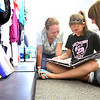 7-11-12<br /> Howard County 4h Fair<br /> Sara Schwarzkopf, 14, Morgan Fetters, 14, and Chelsey Carter, 17, looking at a scrap book in the Consumer Clothing display.<br /> KT photo | Tim Bath