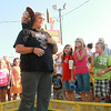 7-12-12<br /> JoJo the Monkey at Howard County Fair<br /> JoJo sits on the shoulders of Julie Kingston while a crowd watches at the Howard County fair.<br /> KT photo | Kelly Lafferty