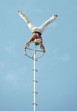 7-10-12<br /> Galaxy Girl Howard Co Fair<br /> Galaxy Girl does a handstand on the top of an 120-foot pole without any sort of safety gear attached.<br /> KT photo | Kelly Lafferty