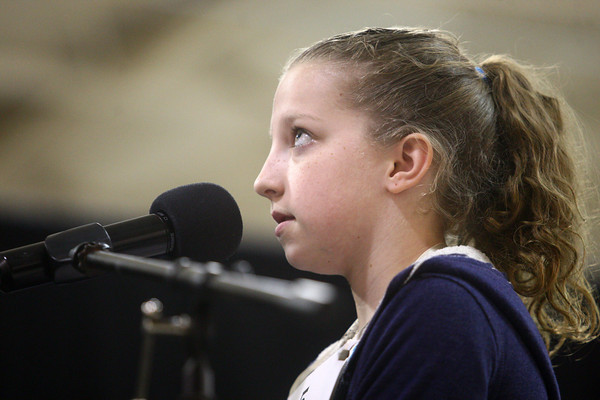 3-18-14<br /> Spelling Bee<br /> Jacy Bradley of Taylor Intermediate School looks upward as she thinks of how to spell a word during the Spelling Bee on Tuesday.<br /> KT photo | Kelly Lafferty