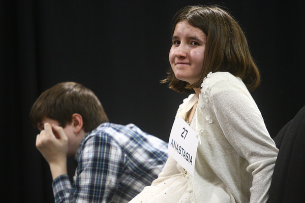 3-18-14<br /> Spelling Bee<br /> Anastasia Spahr of Maconaquah Elementary School smiles as Garrett Rogers of Peru Junior High School rests his heads in his hands after Spahr was named winner of the Spelling Bee on Tuesday evening. Rogers came in second.<br /> KT photo | Kelly Lafferty