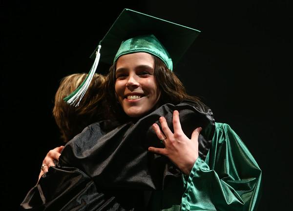 Tresca Schoettmer hugs Shelleen Dawalt after getting her diploma at the Excel Center graduation on December 11, 2015.<br /> Kelly Lafferty Gerber | Kokomo Tribune