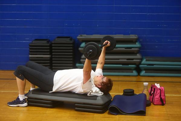 Sandy Knarr participates in a Body Pump fitness class at the Kokomo YMCA on Thursday, July 23, 2015.<br /> Kelly Lafferty Gerber | Kokomo Tribune