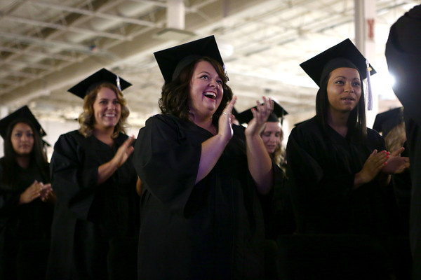 Kaycee Green applauds with her fellow Ivy Tech graduates at the completion of the 2016 Commencement Ceremony on Saturday, May 7, 2016.<br /> Kelly Lafferty Gerber | Kokomo Tribune