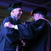 Ivy Tech graduate Robert Sucharski is congratulated by Dr. Thomas McKaig as he walks across the stage during the commencement ceremony on Saturday, May 7, 2016.<br /> Kelly Lafferty Gerber | Kokomo Tribune