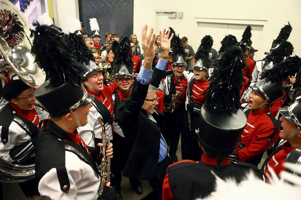 Director Brian Caldwell stands in the center of the group, raises his hands and celebrates with the Marching Panthers after they exit the field at Lucas Oil Stadium. Western High School's marching band brought home a first place trophy in Class C of the State Marching Band Finals on Saturday, October 29, 2016.<br /> Kelly Lafferty Gerber   Kokomo Tribune