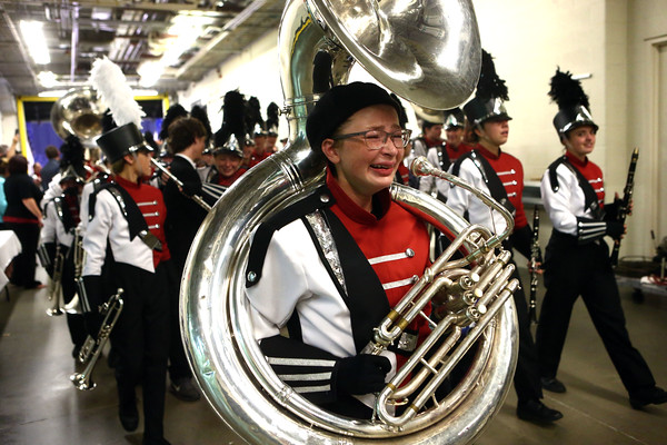 Lexi Shepard gets emotional as she carries her tuba and the Marching Panthers of Western High School exit the field after bringing home a first place in Class C of the State Marching Band Finals at Lucas Oil Stadium on Saturday, October 29, 2016.<br /> Kelly Lafferty Gerber | Kokomo Tribune