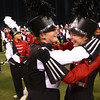 Faith Cochran (left) and Jenna Longworth embrace after the Marching Panthers of Western High School are announced first place victors in Class C of the State Marching Band Finals at Lucas Oil Stadium on Saturday, October 29, 2016.<br /> Kelly Lafferty Gerber | Kokomo Tribune