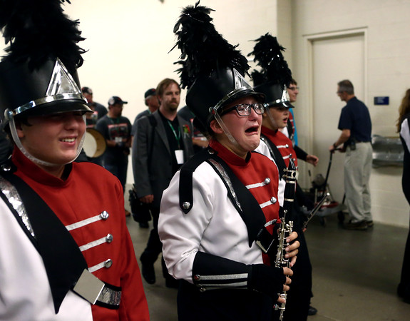 Cameron Stewart cries as the Marching Panthers exit the field after winning first place in Class C of the State Marching Band Finals at Lucas Oil Stadium on Saturday, October 29, 2016.<br /> Kelly Lafferty Gerber | Kokomo Tribune