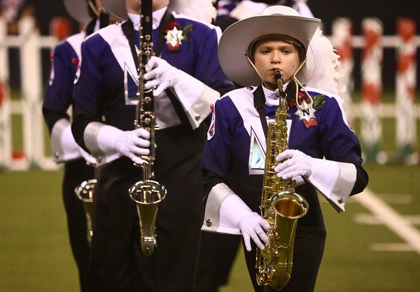 Emily Tharp plays the alto sax as Northwestern High School performs in Class D of the State Marching Band Finals at Lucas Oil Stadium on Saturday, October 29, 2016. The Tigers placed eighth.<br /> Kelly Lafferty Gerber   Kokomo Tribune