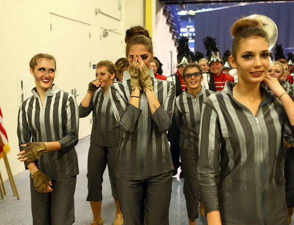 Hailey Shipp (center) covers her face as she reacts to Western's first place victory in Class C of the State Marching Band Finals at Lucas Oil Stadium on Saturday, October 29, 2016.<br /> Kelly Lafferty Gerber   Kokomo Tribune
