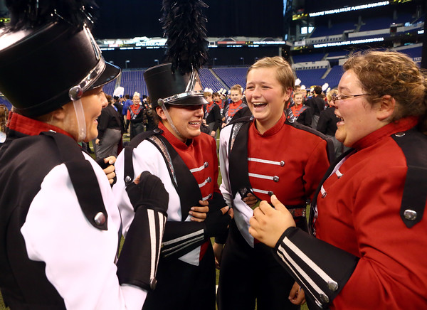 From left: Ashley Conyers, Esther Mullins, Adi Smith, and Audrey Freeman celebrate as the Marching Panthers of Western High School are announced first place victors in Class C of the State Marching Band Finals at Lucas Oil Stadium on Saturday, October 29, 2016.<br /> Kelly Lafferty Gerber | Kokomo Tribune