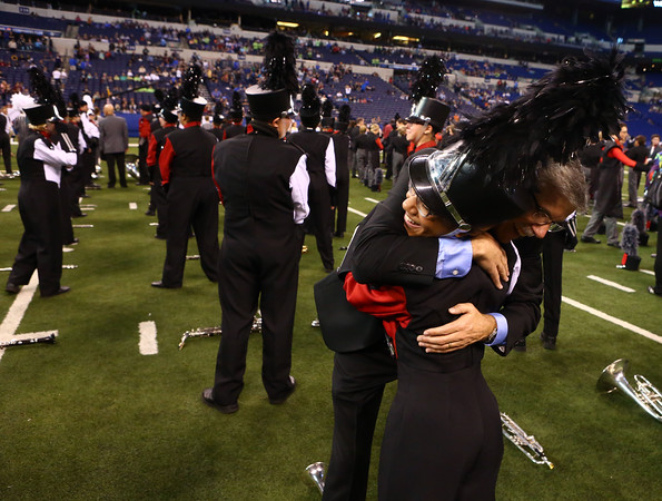 Faith Salinas hugs director Brian Caldwell after it's announced that the Marching Panthers of Western High School received first place in Class C of the State Marching Band Finals at Lucas Oil Stadium on Saturday, October 29, 2016.<br /> Kelly Lafferty Gerber   Kokomo Tribune