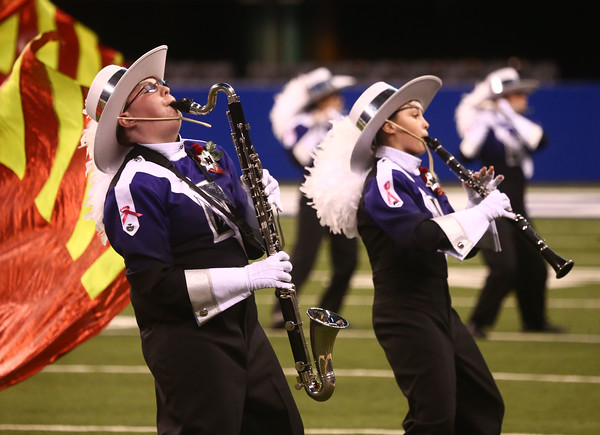 Clay Wilson (left) on the bass clarinet and Sarah Harris on the clarinet performs with Northwestern High School in Class D of the State Marching Band Finals at Lucas Oil Stadium on Saturday, October 29, 2016. The Tigers placed eighth.<br /> Kelly Lafferty Gerber | Kokomo Tribune