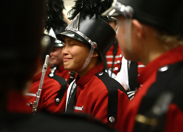 Lia Lipinski shuts her eyes for a moment as she relishes in the Marching Panthers victory after Western High School brought home a first place trophy in Class C of the State Marching Band Finals at Lucas Oil Stadium on Saturday, October 29, 2016.<br /> Kelly Lafferty Gerber | Kokomo Tribune