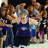 Shortcake Slammer high fives the City of Fists roller derby fans after her name is announced in the line up for the COF's first home bout against Richmond's Dire Skates on Saturday, September 24, 2016.<br /> Kelly Lafferty Gerber | Kokomo Tribune