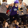 Thuggz of the City of Fists roller derby team tries to break away from the pack to become the Lead Jammer during the COF's first home bout on Saturday, September 24, 2016. The City of Fists defeat Richmond's Dire Skates.<br /> Kelly Lafferty Gerber | Kokomo Tribune