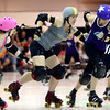 Skatie Splatter, a Jammer for the City of Fists roller derby, breaks away from the Dire Skates to become Lead Jammer for the COF's first home bout on Saturday, September 24, 2016.<br /> Kelly Lafferty Gerber | Kokomo Tribune