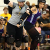 Rita Roundhouse, a blocker for the City of Fists roller derby team, tries to block Dire Skates' Jammer Dragon Ballzy during COF's first home bout on Saturday, September 24, 2016.<br /> Kelly Lafferty Gerber | Kokomo Tribune