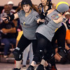 Jammer Sonic Piledriver works to break through a pack of Dire Skates' blockers during the City of Fists roller derby first home bout on Saturday, September 24, 2016.<br /> Kelly Lafferty Gerber | Kokomo Tribune