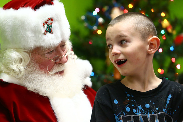 Bill and Janice Roe look forward to visiting Bon Air Elementary's Life Skills class every year as Santa and Mrs. Claus. The kids hold a special place in their hearts. Their son Jamie, who was born with cerebral palsy and a mild mental disability died of cancer in 2003 when he was just 30.<br /> Kelly Lafferty Gerber | Kokomo Tribune