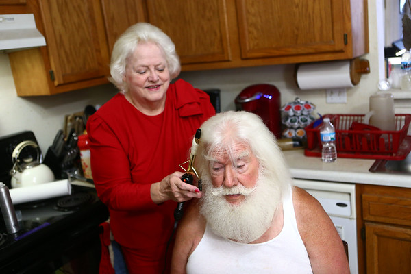 Janice Roe curls her husband Bill Roe's hair in the kitchen as they prepare for an outing. It usually takes Janice about 20 minutes to curl his hair. Kelly Lafferty Gerber | Kokomo Tribune