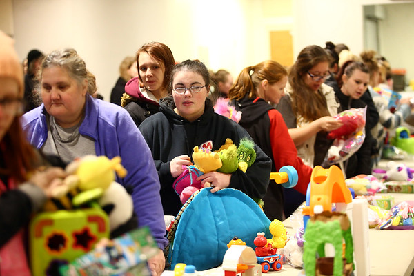 Attendees of the Sharing and Caring event at UAW 685 on December 20, 2017, search for the perfect toy to give to their children for Christmas.<br /> Kelly Lafferty Gerber | Kokomo Tribune