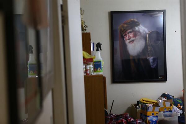 An award-winning portrait taken of Santa Bill Roe hangs in his Kokomo home.<br /> Kelly Lafferty Gerber | Kokomo Tribune