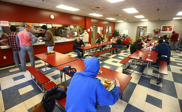 People gather for dinner in the dining room of the Kokomo Rescue Mission on Wednesday, December 27, 2017. KRM has opened its doors as a warm-up shelter with frigid temperatures in the forecast this week.<br /> Kelly Lafferty Gerber | Kokomo Tribune