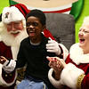 Lavertae Mason can't contain his excitement as he sits in between Bill and Janice Roe, more commonly referred to as Santa and Mrs. Claus. The Roes look forward to their visit to spread Christmas cheer in Bon Air Elementary's Life Skills class every year.<br /> Kelly Lafferty Gerber | Kokomo Tribune