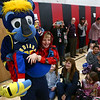 Boomer, the Indiana Pacers mascot, carries 8-year-old Liam Shane to the front of the gym at Taylor Elementary on Tuesday, December 19, 2017.<br /> Kelly Lafferty Gerber | Kokomo Tribune