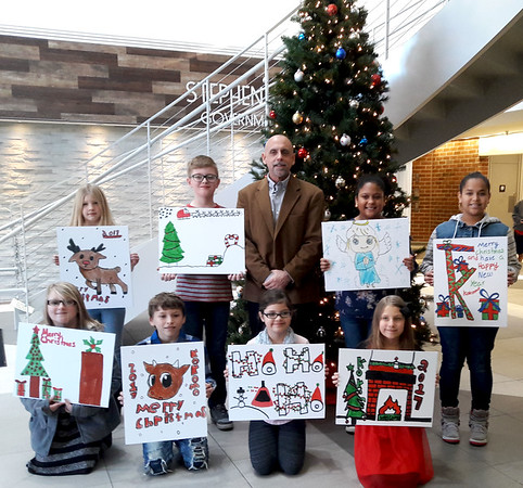 Leevi Combs Wins MayorÕs 2017 Christmas Card Contest and poses with Mayor Greg Goodnight and the other finalists on December 1, 2017.<br /> Provided Photo