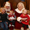 Bill and Janice Roe entertain siblings from left: Lincoln, Lewis, and Lucy Amos, as Santa and Mrs. Claus during a Christmas party at the Elliott House in December.<br /> Kelly Lafferty Gerber | Kokomo Tribune
