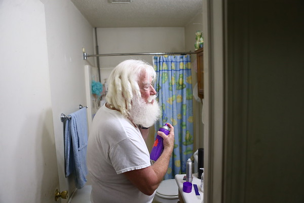 Bill curls and shapes his beard before donning his big red Santa suit.<br /> Kelly Lafferty Gerber | Kokomo Tribune