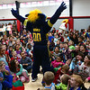 Boomer, the Indiana Pacers mascot, responds to the screams and laughter as he entertains students at Taylor Elementary on Tuesday, December 19, 2017.<br /> Kelly Lafferty Gerber | Kokomo Tribune