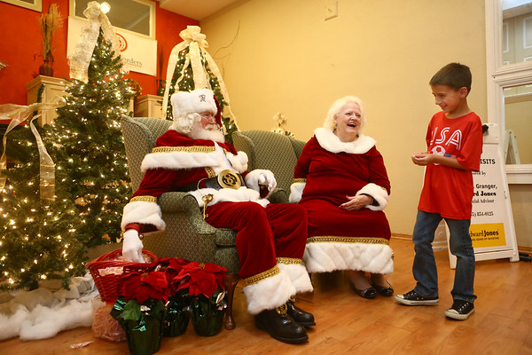 Bill and Janice Roe listen to children's Christmas wishes during December's First Friday.<br /> Kelly Lafferty Gerber | Kokomo Tribune
