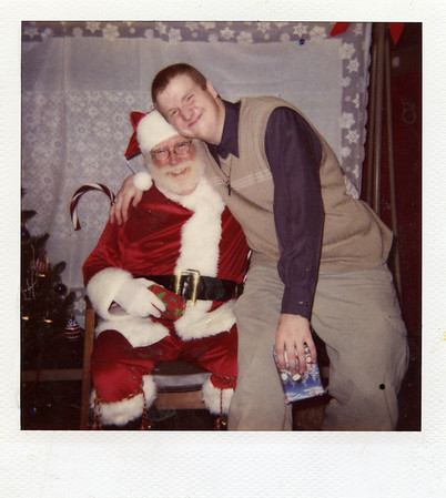 Santa Bill Roe poses for a photo with his youngest son, Johnny, in the mid-1990s.<br /> Submitted photo