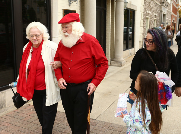 Because of their uncanny resemblances to the Clauses, Janice and Bill Roe elicit stares everywhere they go, even while they stroll through September's First Friday in downtown Kokomo.<br /> Kelly Lafferty Gerber | Kokomo Tribune