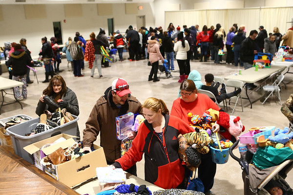 Attendees of the Sharing and Caring event at UAW 685 on December 20, 2017 look through items as they search for the perfect gift for their children.<br /> Kelly Lafferty Gerber | Kokomo Tribune