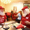 Bill Roe, right, talks with fellow Indiana Santa from Fishers, Mark Petersen, at Martino's Italian Villa in Kokomo during the monthly Hoosier Santa get-together.<br /> Kelly Lafferty Gerber | Kokomo Tribune