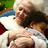 Janice Roe, also known as Mrs. Claus, gives Lakeisha Linback a hug during a visit to Bon Air Elementary's Life Skills class earlier this month.<br /> Kelly Lafferty Gerber | Kokomo Tribune