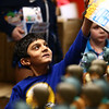 Anay Patel, 6, picks out a Star Wars action figure, one of the thousands of toys donated by the Indiana Pacers to Taylor Elementary on Tuesday, December 19, 2017.<br /> Kelly Lafferty Gerber | Kokomo Tribune