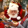 Lilly and Landon Wong tell Santa Bill Roe what they want for Christmas in between photo sessions at Julie Mar-K-Z Photography.<br /> Kelly Lafferty Gerber | Kokomo Tribune