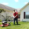 Even as Bill Roe mows his front yard on a hot summer day in June, he wears a red shirt. Bill, a retired Chrysler tool setter, hasn't cut his Santa Claus beard since 2005. <br /> Kelly Lafferty Gerber | Kokomo Tribune