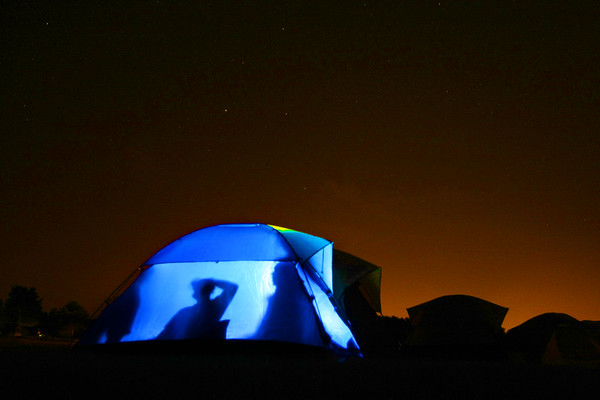 Playing around with exposures at a campout. The kids in the tent are illuminated with a flashlight. The glow in the sky is from Kokomo about 7 miles away.<br /> Camera: Canon EOS-1D Mark III - ISO: 1600 - Shutter Speed: 1.3 seconds - Aperture f2.8 - Lense 16-35 @ 26mm<br /> KT photo | Tim Bath